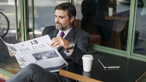 A business owner reading a paper